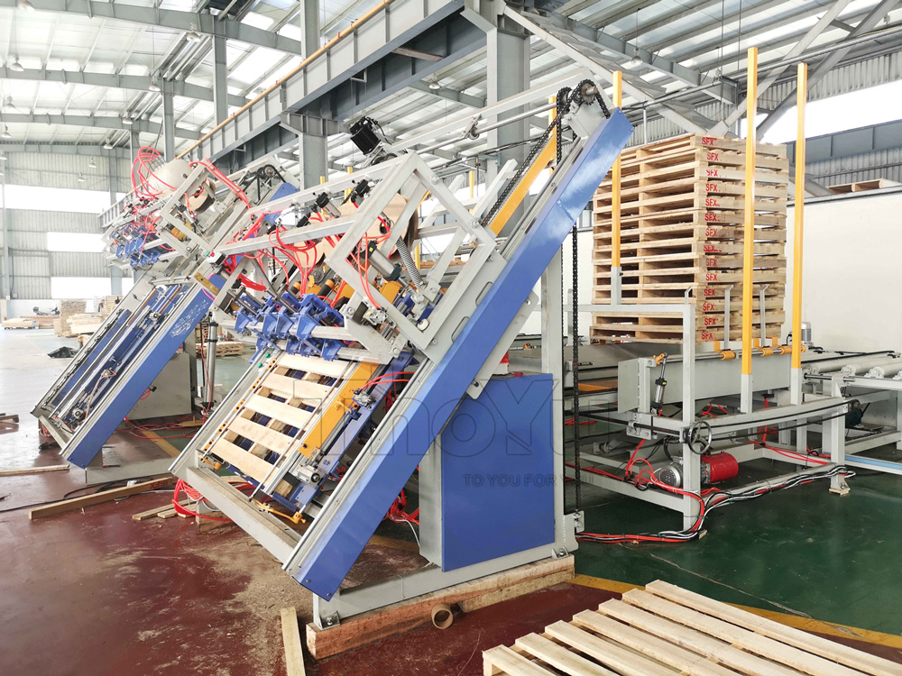 Automatic wood pallet nailing machine